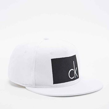 Calvin Klein Arlo Snapback Cap in White and Black - Urban Outfitters