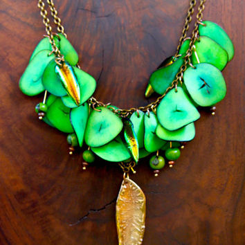 On SALE Rainforest Green Tagua Necklace Lush Cluster of Curved Tagua Slices w Iridescent Bronze Elytra Beetle Wings Botanical Necklace