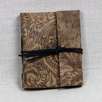 Exposed stitch, hand bound leather wrap journal