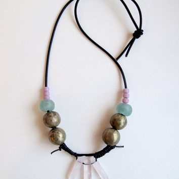 Rose quartz crystal necklace with African clay and metal beads, blue glass beads and pink Native American crow beads on thick black leather