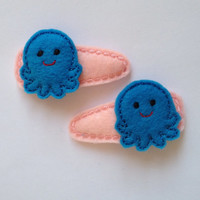 Sweet little Octopus felt snap clip barrettes in Blue with light pink snap clip covers. This is a set of 2  $5.50