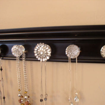 Jewelry organizer . This wall necklace holder rack features rhinestone center 5 knobs total on black gloss finished 15 inches long