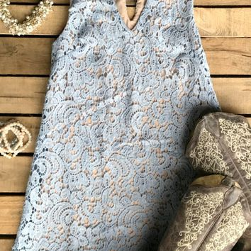 I'm not sure what you can do in this dress, but I know what you can't do with it: Leave it on this page! It's just too pretty!​Haltered v-neck, crochet lace, button key-hole back, scalloped hem, lined.