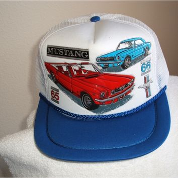 '65-66 Mustang in 3 - D graphics on a new white mesh cap w/blue trim