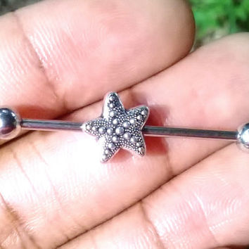 Sale.......cute little sea starfish designed on both sides Industrial barbell 14 gauge stainless steel earrings