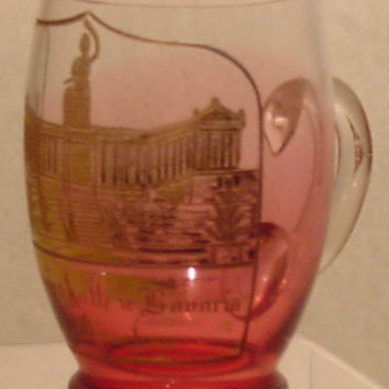 910328 Cranberry To Crystal Glass With Handle, Panel Of Engraved Building Painted Gold & Gold Rim