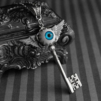 Winged skeleton key necklace with blue eyeball cabochon - gothic - steampunk jewelry