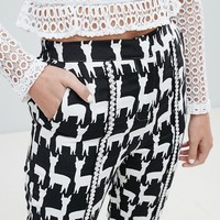 Sister Jane Cigarette Trousers With Front Stripe In All Over Llama Print at asos.com