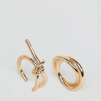 ASOS DESIGN Pack of 2 Sleek Interlocking Band and Knot Rings at asos.com