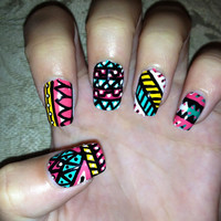 Hand painted set of fake nails with tribal/aztec patterns.