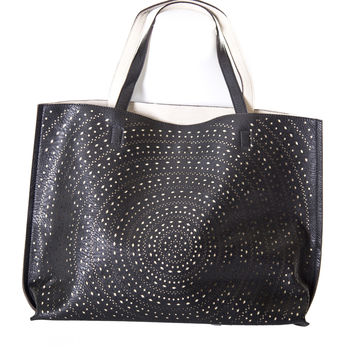 Brina Lasercut Reversible Tote Handbag In Black & Ivory