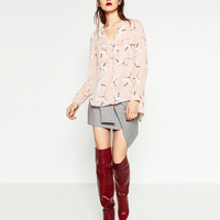 PRINTED BLOUSE WITH PLUNGING NECKLINEDETAILS