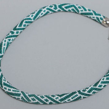 Handmade designer beaded cord necklace with white and turquoise colors pattern