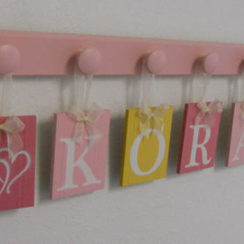 Childrens Personalized Decor Name Signs Includes 6 Peg Hooks and Babies Name KORA with HEARTS Pinks and Yellow. Baby Girls Room Wall Decor