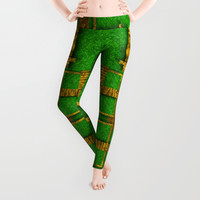 golden green and  sunshine pop-art Leggings by Pepita Selles