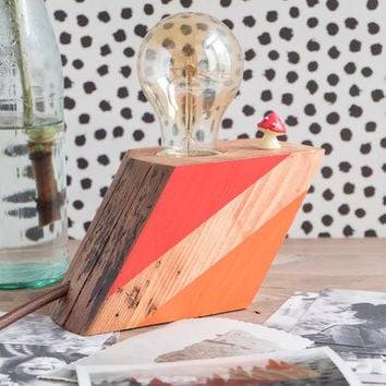 Small wood lamp with modern red and orange decors on sides