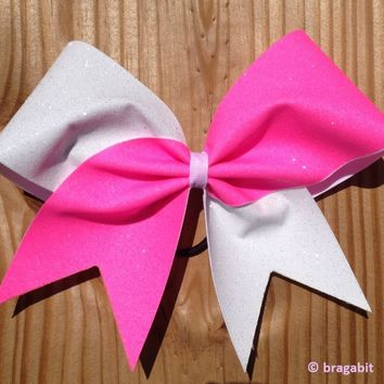 Neon pink and white glitter cheer bow.