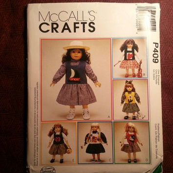 "Uncut 1998 McCall's Sewing Pattern, P409! 18"" Doll Clothes/Blouse/Jumper/Sailboat Appliques/Pumpkin/Snowman/Flower/Hearts/Flags/Accessories"