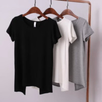 FREE SHIPPING The new spring look is a soft, loose, open-back T-shirt with a big, solid-colored undershirt