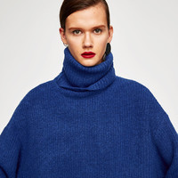 OVERSIZED ROLL NECK SWEATER DETAILS