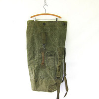 vintage army green rucksack. canvas laundry bag. duffle bag US military 1960s stenciled nice wear patina