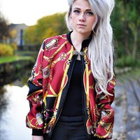 Dark red oversized chain print bomber jacket from The Left Bank