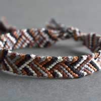 Handmade woven bracelet macrame technique unisex woven accessory in brown color