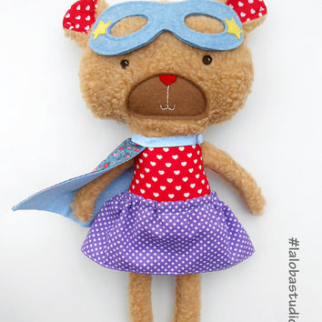 Teddy bear in superhero look, bear plushie with heart design for valentine's day, an adorable stuffed toy's a great gift for kids and adults