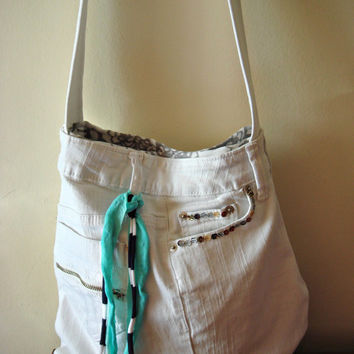 Upcycled crossbody bag in white jeans decorated with sequins and a ribbon. Crossbody diaper bag