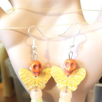 glow in the dark earrings sugar skulls butterfly dangles orange yellow day dead