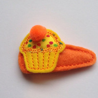 Cupcake felt snap clip barrette in bright yellow orange felt and with yellow multi color dots. $3.00
