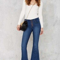 High Rise Against Flare Jeans