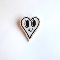 Embroidered heart brooch with smily face in black and white kitsch jewelry An Astrid Endeavor