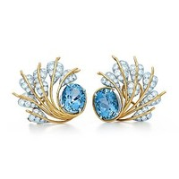 Tiffany & Co. -  Schlumberger Seven Leaves ear clips in 18k gold and platinum with diamonds.