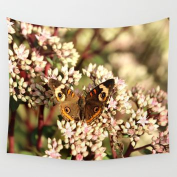 Buckeye Butterfly On Pale Pink Flowers Wall Tapestry by Theresa Campbell D'August Art