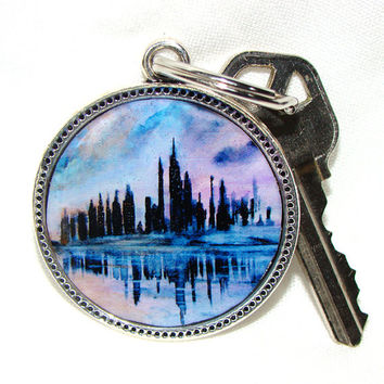 Keychain Cityscape purple, blue, pink, silver colored round metal key ring key fob pendant featuring a reproduction of my painting