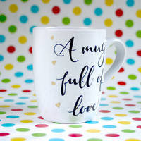 "Hand painted mug with golden hearts and text ""A mug full of love"""