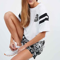 Reebok X Melody Ehsani Cropped Tee in White - Urban Outfitters