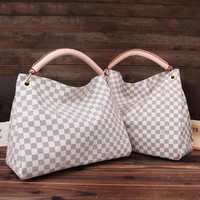 Louis Vuitton Artsy Hobo Bag (available in multiple colors and sizes)