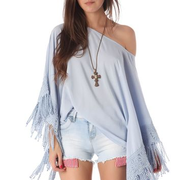Blue fringed batwing sleeve tunic top