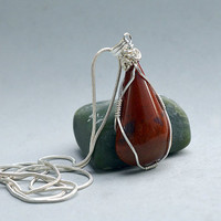 Red Jasper pendant pear shape silver wire wrapped with a silver plated necklace
