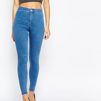 ASOS Rivington High Waisted Denim Jeggings in Maisy Mid Wash Blue at asos.com
