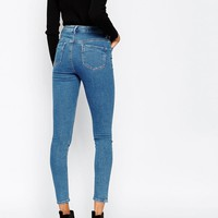 ASOS | ASOS Ridley High Waist Skinny Jeans in Lily Pretty Mid Stonewash at ASOS