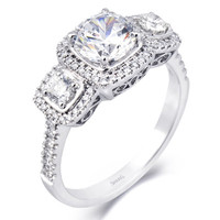 Simon G. 18K White Gold Three Stone Diamond Halo Engagement Ring Featuring 0.64 Carats of White Diamonds