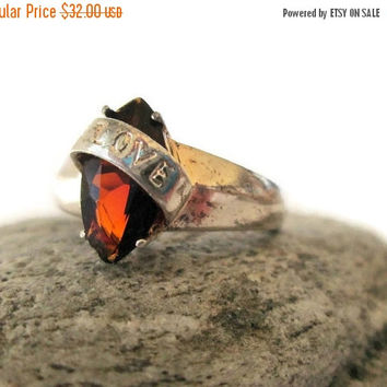 ON SALE Sterling Silver Garnet Ring, Love Ribbon Cross Over band, Marquise Garnet,  Size 7.5, Valentine's Day Ring, January Birthstone