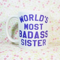 WORLD'S MOST BADASS Sister Coffee Mug