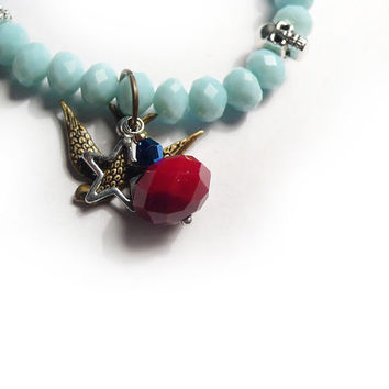 Opaque Baby Blue Faceted Glass Bracelet with Charms. Charm Bracelet. Swallow Bracelet. Skull Bracelet
