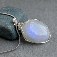 Moonstone pendant oval shape silver wire wrapped with a silver plated necklace