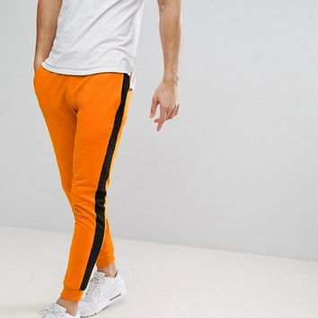 Only & Sons Joggers In Orange With Black Track Stripe at asos.com