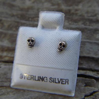 Small skull stud earrings in sterling silver